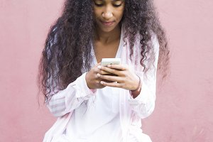 afro girl with mobile phone