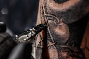 Artist tattooing