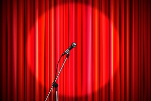 Red curtain with shiny microphone