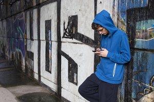 Urban boy with phone