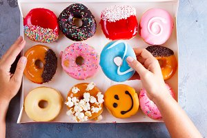 sweet doughnuts on gray stone background