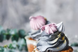 Pastel color cupcakes with cream