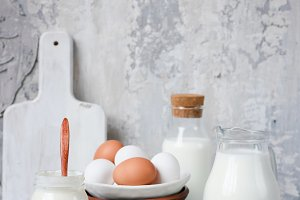 Dairy products on gray concrete background