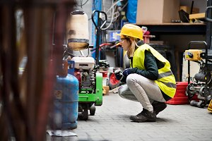 Young female worker in a warehouse.