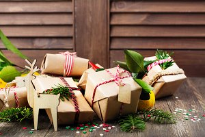 Many decorated Christmas presents on wooden background