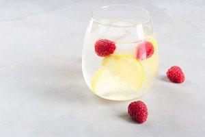 Drink with raspberries and lemon, ice