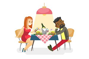 Young multiracial couple at romantic date.