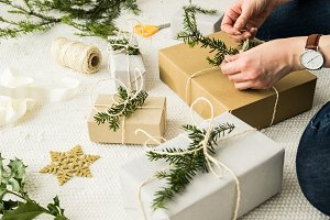 Woman wrapping Christmas gifts III