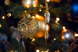 gold Christmas toy in the form of a ball hanging