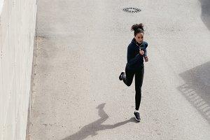 Female runner on city street
