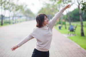 Portrait Asian woman in a park.