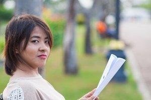 Portrait Asian woman sitting reading