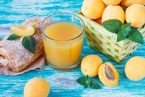 Apricots, puff with golden crust and glass of juice