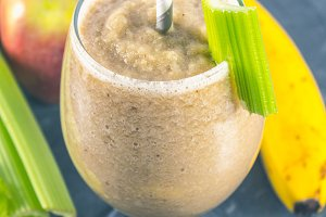 Green smoothie with celery, banana and apple