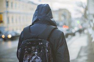 Student walking through city street