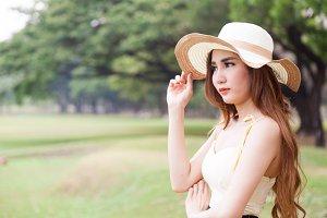 Asian women wearing hat standing