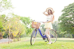 asian woman hold bicycle