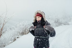 Woman enjoying walk in snowy country
