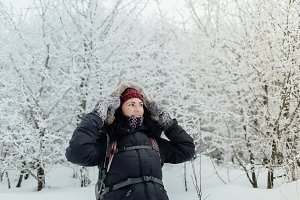 Smiling woman enjoying winter forest