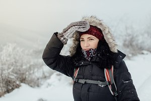 Worried female tourist in winter
