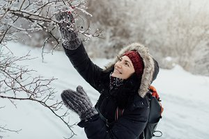 Smiling woman enjoying snowy country