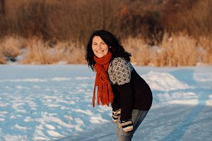 Woman ice skating on a frozen lake