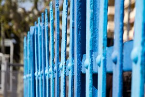 Fence with blue metal slats (1)