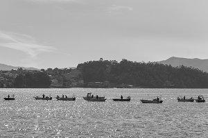 Fishers fishing in Galicia, Spain.