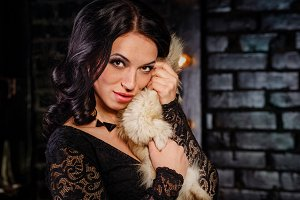 Girl in a black dress and furs