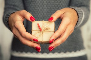 hands hold christmas gift box