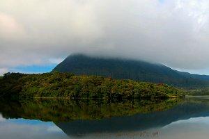 Reflection of Gregory lake in Nuwara Eliya in the fog