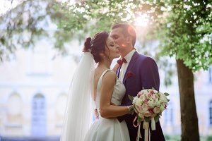 Groom and bride kiss each other