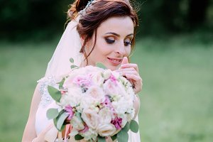 A bride with bouquet of flowers