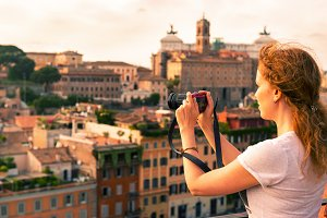 Girl takes a picture in Rome