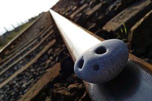 Rock on train rails