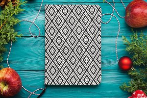 Christmas dark green frame background and notebook