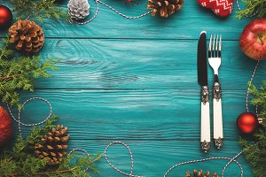 Christmas dark green frame background with cutlery