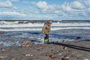 kid on the shore of the Baltic Sea