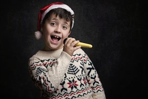 child singing Christmas carol