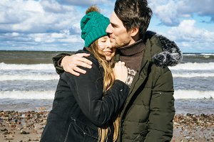 couple in love and cold Baltic sea