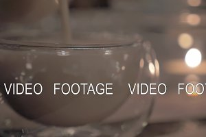 Pouring masala tea into a glass tea bowl