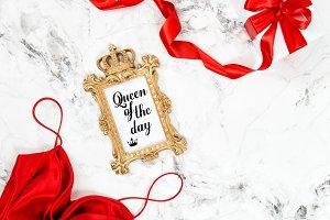Red dress, golden frame, gift box
