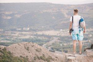 Man tourist is standing on the wall of Jvari Monastery, Georgia