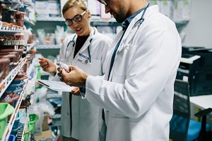 Pharmacists checking inventory