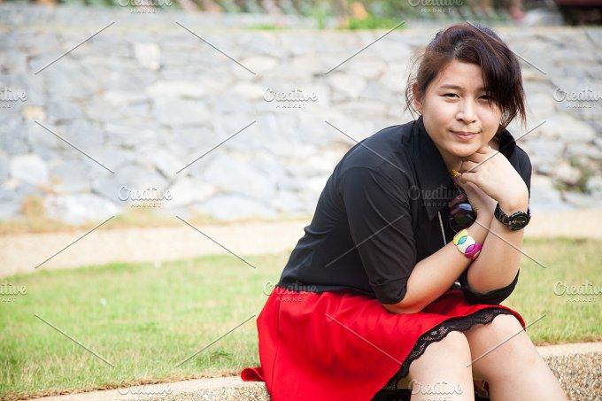 Asian women black shirt. Sitting - People