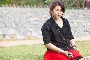 Asian women black shirt. Sitting