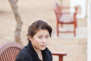 Asian women black shirt.