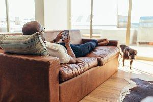 Man lying on lounge