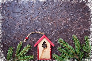 Christmas background with wooden birdhouse