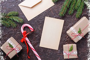 Gift boxes, candy cane and letter.